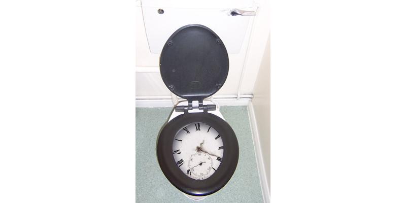 clock-in-toilet